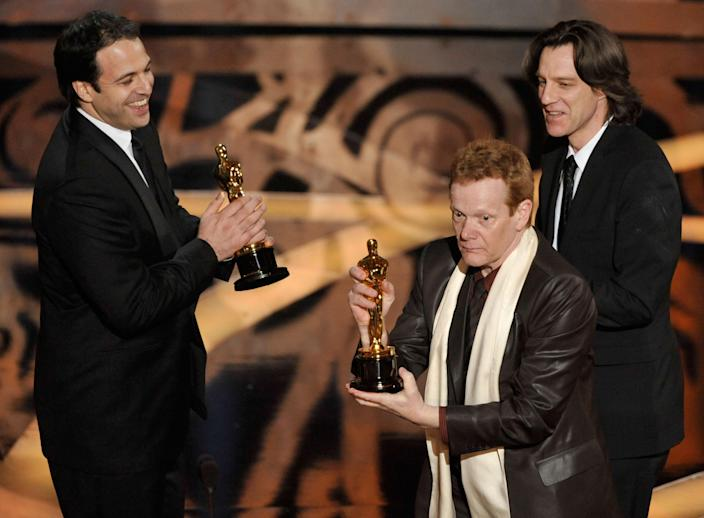 (L-R) Producer Simon Chinn, performance artist Philippe Petit and director James Marsh accept the Best Documentary award for 'Man on Wire' during the 81st Annual Academy Awards held at Kodak Theatre on February 22, 2009 in Los Angeles, California. (Photo by Kevin Winter/Getty Images)