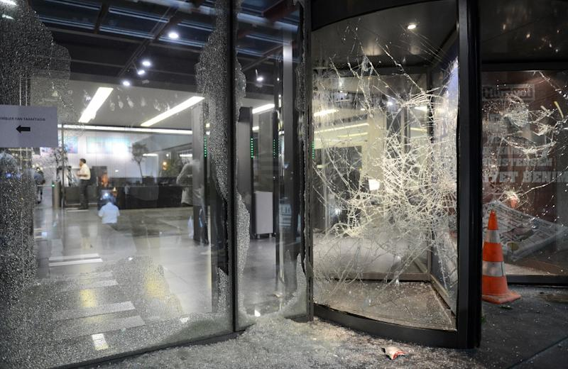 This photo taken on September 8, 2015 shows broken windows at the headquarters of the Hurriyet newspaper on September 8, 2015 (AFP Photo/)