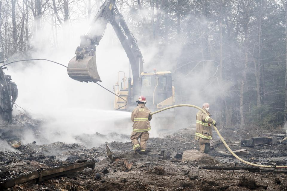 Firefighters work to extinguish a fire at the Doris Duke Theatre at Jacob's Pillow in Becket, Mass., that burned in an early morning fire, Tuesday, Nov. 17, 2020. At the peak of the fire, about 30 firefighters worked to control the blaze. Departments from Hinsdale, Otis, Lee, Monterey and Chester assisted Becket. The Doris Duke Theatre is one of two indoor theaters on the grounds of Jacob's Pillow. (Ben Garver/The Berkshire Eagle via AP)