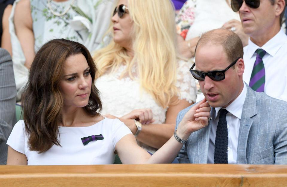 <p>Kate enjoyed a moment of rare public affection with her husband, wiping something off his chin as they attended day 13 of Wimbledon, July 2017. </p>