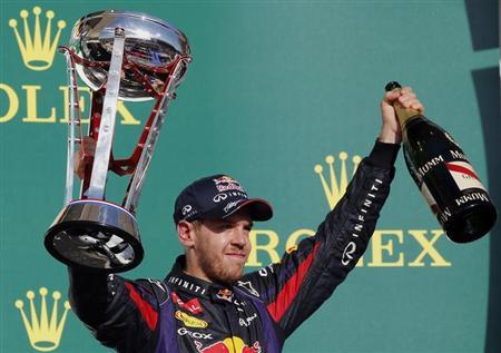 Sebastian Vettel of Germany celebrates with his trophy on the podium after winning the Austin F1 Grand Prix at the Circuit of the Americas in Austin