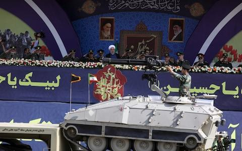 Iranian President Hassan Rouhani is seen during the ceremony of the National Army Day parade in Tehran - Credit: Wana News Agency