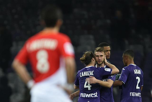 Soccer Football - Ligue 1 - Toulouse vs AS Monaco - Stadium Municipal de Toulouse, Toulouse, France - February 24, 2018 Toulouse's Yannick Cahuzac and Alexis Blin celebrate after the match REUTERS/Fred Lancelot