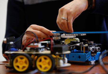 FILE PHOTO: A research support officer and PhD student works on his artificial intelligence projects to train robots to autonomously carry out various tasks, at the Department of Artificial Intelligence at the University of Malta in Msida