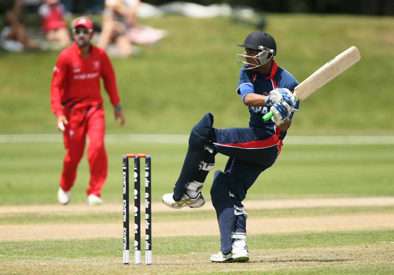 RANGIORA, NEW ZEALAND - JANUARY 19:  Sompal Kami of Nepal batting during the ICC Cricket World Cup Qualifier match between Hong Hong v Nepal at Main Power Oval in Rangiora on January 19, 2014 in Rangiora, New Zealand.  (Photo by Joseph Johnson-IDI/IDI via Getty Images)