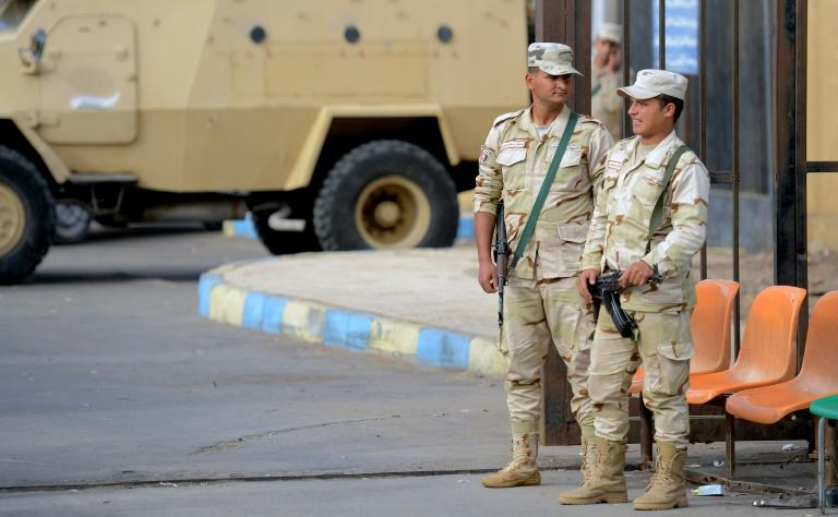 Egyptian soldiers stand guard at a hospital treating the wounded from a jihadist attack that killed more than 300 worshippers at a Sinai mosque on November 24, 2017