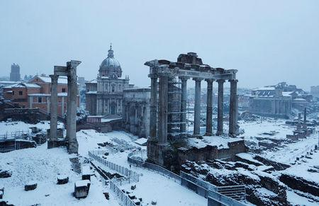 Roman Forum is seen during a heavy snowfall early in the morning in Rome. REUTERS/Remo Casilli