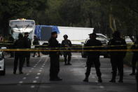 Police stand guard at a crime scene where the chief of police was attacked by gunmen in the early morning hours, in Mexico City, Friday, June 26, 2020. Heavily armed gunmen attacked and wounded Omar Garcia Harfuch in a brazen operation that left an unspecified number of dead, Mayor Claudia Sheinbaum said Friday. (AP Photo/Rebecca Blackwell)