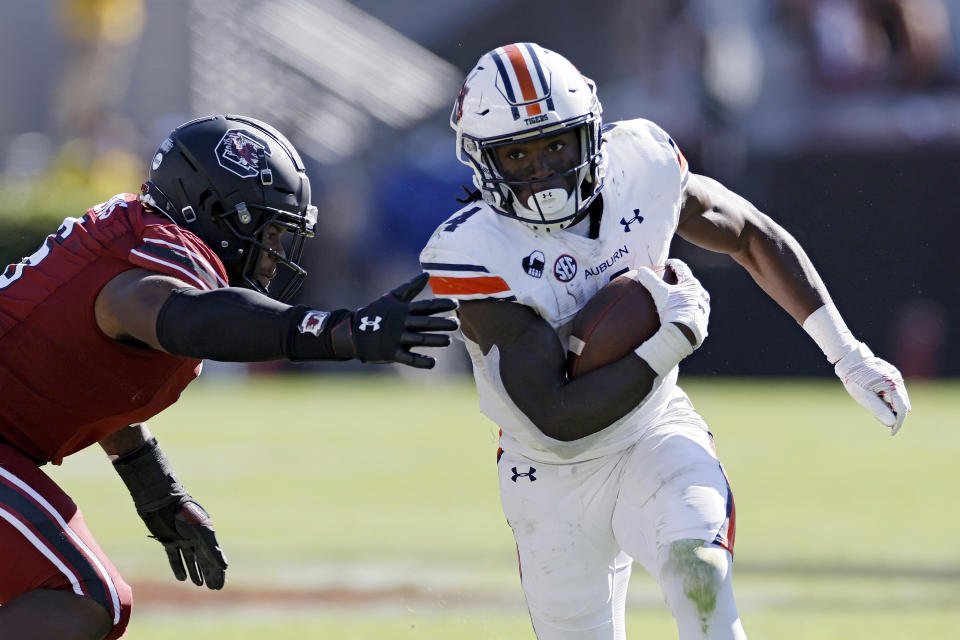 COLUMBIA, SC - OCTOBER 17: Tank Bigsby #4 of the Auburn Tigers runs with the ball against the South Carolina Gamecocks in the third quarter of the game at Williams-Brice Stadium on October 17, 2020 in Columbia, South Carolina. The Gamecocks won 30-22. (Photo by Joe Robbins/Getty Images)