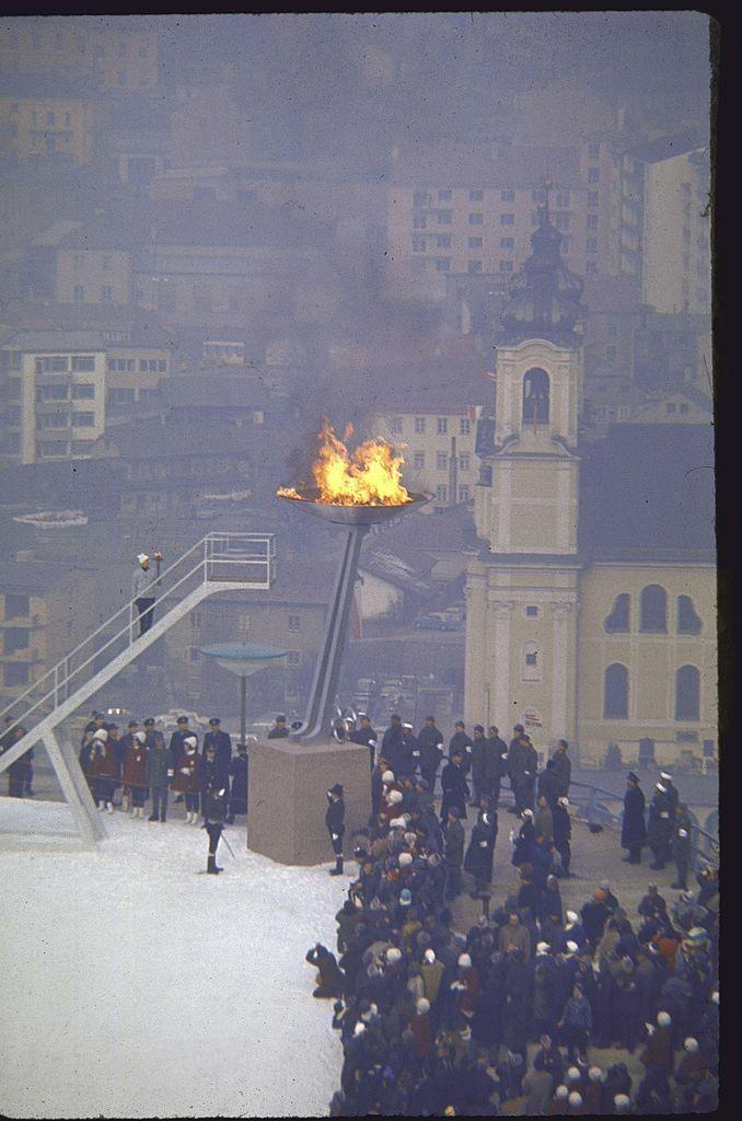 <p>The Vienna Philharmonic opens the Games, which were held at an interesting time for Innsbruck — the normally snowy city was having a decidedly un-snowy winter. The Austrian army had to carve and carry 20,000 ice bricks from a mountain to create the luge and bobsled runs, and 40,000 tons of snow to the skiing courses.</p>