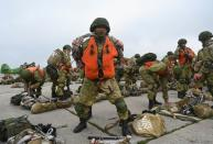 Russian paratroopers take part in drills at a military aerodrome in Taganrog