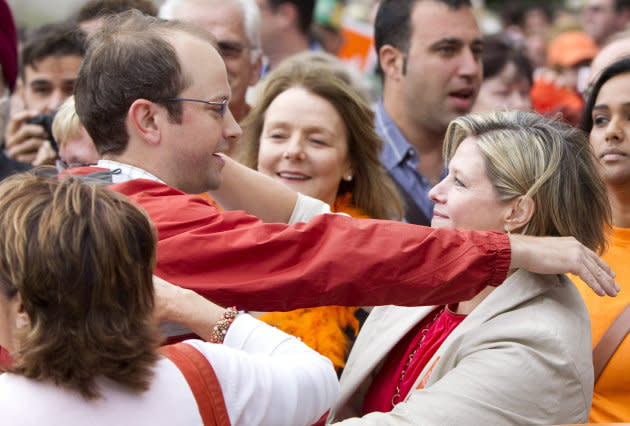Toronto Coun. Mike Layton hugs Ontario NDP Leader Andrea Horwath at a labour day parade in 2011.