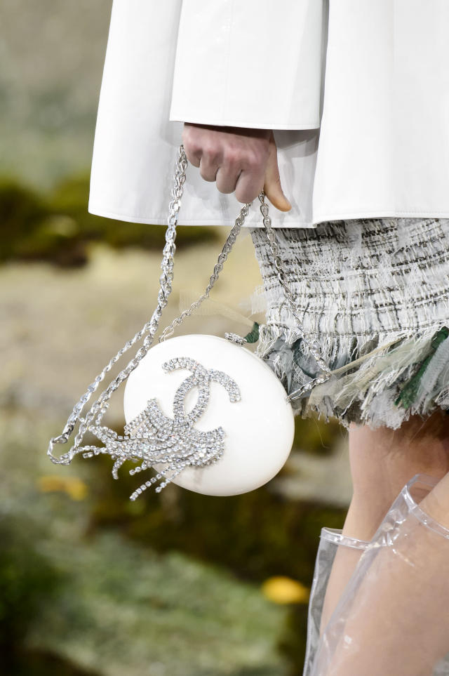 <p><i>White evening back with jewel embellishments from the SS18 Chanel collection. (Photo: ImaxTree) </i></p>