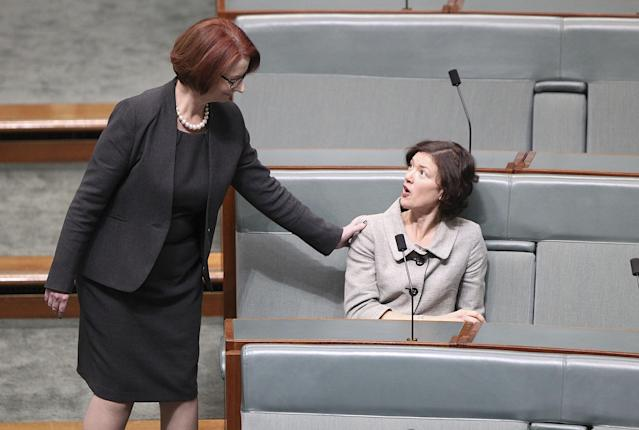 CANBERRA, AUSTRALIA - JUNE 27: Former PM Julia Gillard (L) greets friend and MP, Kirsten Livermore in the House of Representatives on June 27, 2013 in Canberra, Australia. Kevin Rudd won an Australian Labor Party leadership ballot 57-45 last night, and will be sworn in this morning as Australian Prime Minister by Governor-General Quentin Bryce. Rudd was Prime Minister from 2007 to 2010 before he was dumped by his party for his deputy Julia Gillard. Gillard has announced that she will leave parliament and not contest her seat following her ballot loss. (Photo by Stefan Postles/Getty Images)