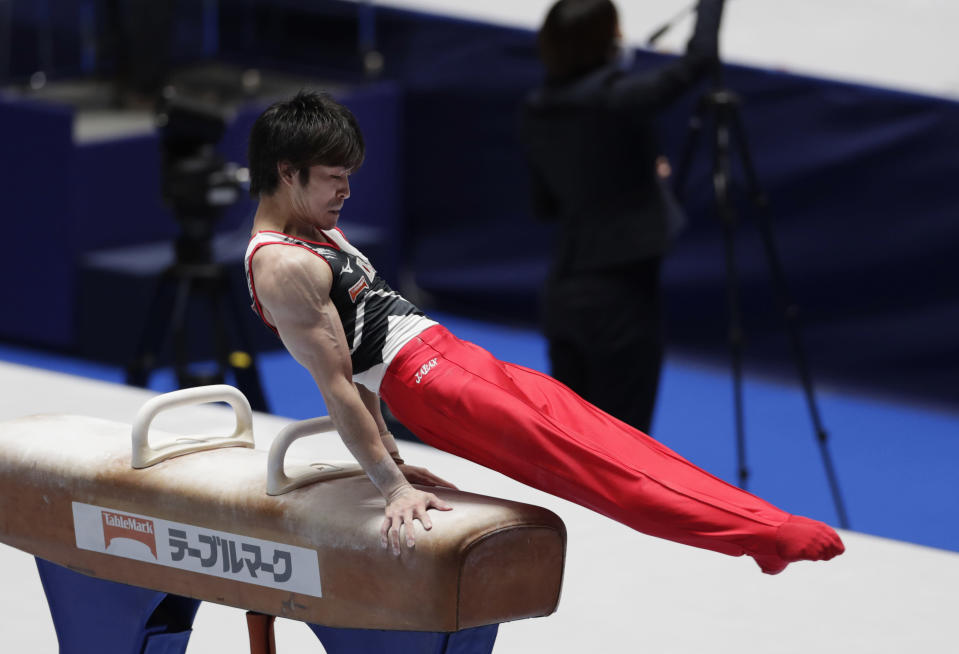 Kohei Uchimura of Japan competes in the pommel horse during an international gymnastics meet in Tokyo on Sunday, Nov. 8, 2020. Three-time Olympic gold-medal gymnast Uchimura wants the postponed Tokyo Olympics to happen in just under nine months. But he's also talked openly about the skepticism in Japan where enthusiasm is muted by health risks, billions of dollars in taxpayer bills, and questions why the Games are a priority amid a pandemic. (AP Photo/Hiro Komae)