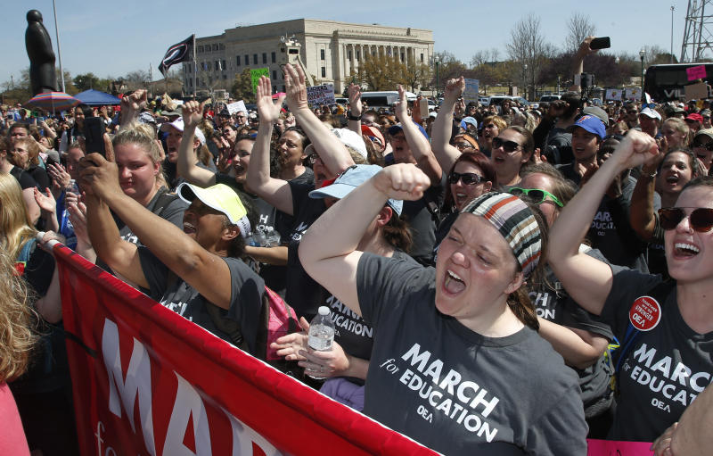 FILE- In this April 10, 2018, Madeline Jacobson, a third grade teacher in Tulsa, protests at the Capitol, in Oklahoma City, Okla. Months after massive teacher walkouts energized many like never before, teachers and their unions are coming to terms with the midterm elections' mix of wins and losses. (AP Photo/Sue Ogrocki, File)