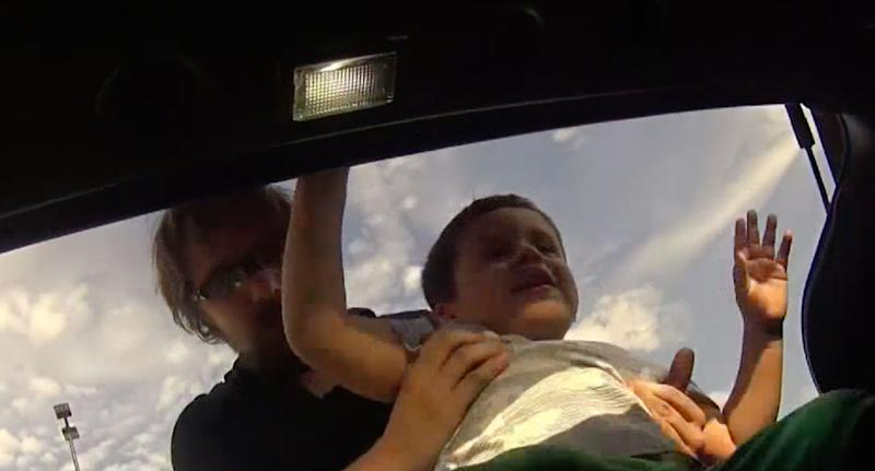 Boguslaw Matlak, 28, who was filmed placing his three-year-old son in the boot of his car claims it was a social experiment to see if people would intervene. Source: NBC 5