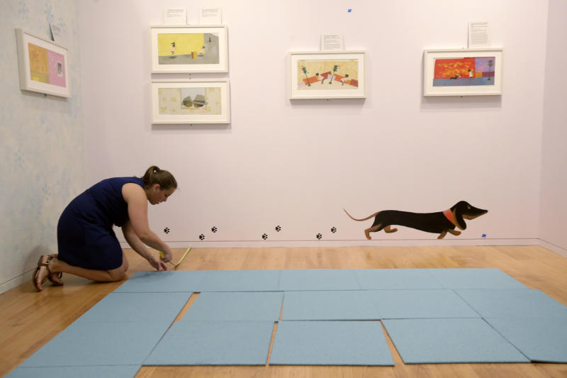 In this Tuesday, July 16, 2013 photo, registrar Sasha Makuka makes preparations for The Snowy Day and The Art Of Ezra Jack Keats exhibition at the National Museum of American Jewish History, in Philadelphia. The exhibition opened July 19. (AP Photo/Matt Rourke)