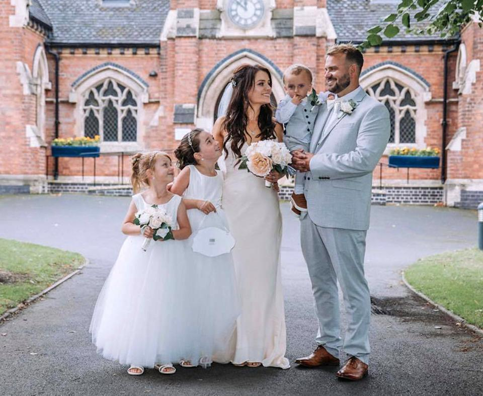 The couple saved thousands on their dream day. Pictured with children Morgan, 10 (second lef) and Shelby 8, and the couple's son Jett, 2. (Caters)