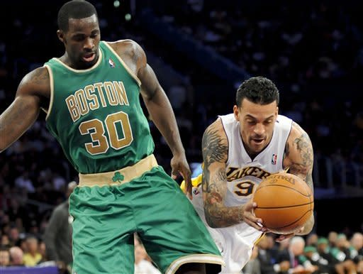 Boston Celtics forward Brandon Bass (30) and Los Angeles Lakers forward Matt Barnes (9) collide in the first half of an NBA basketball game, Sunday, March 11, 2012, in Los Angeles. (AP Photo/Gus Ruelas)