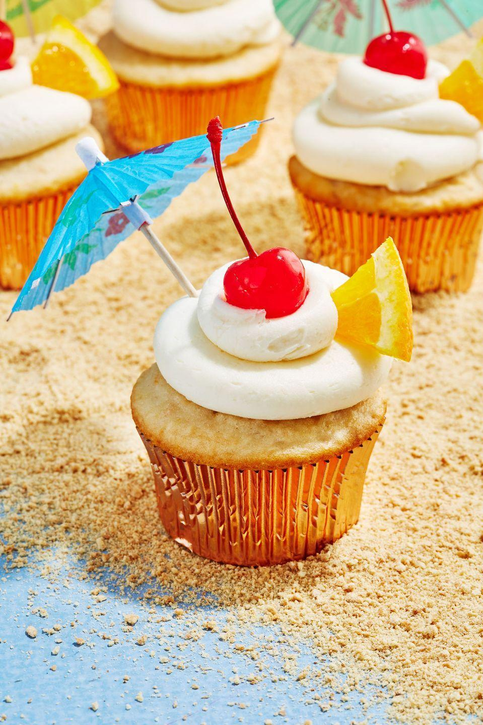 """<p>This cupcake immediately takes you on a tropical vacation.</p><p>Get the recipe from <a href=""""https://www.delish.com/cooking/recipe-ideas/a19487384/bahama-mama-cupcakes-recipe/"""" rel=""""nofollow noopener"""" target=""""_blank"""" data-ylk=""""slk:Delish"""" class=""""link rapid-noclick-resp"""">Delish</a>. </p>"""