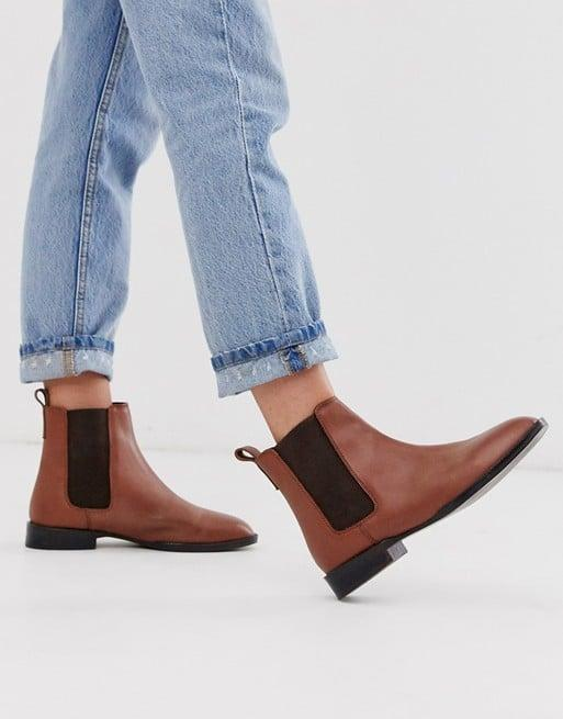 "<p>These comfy <a href=""https://www.popsugar.com/buy/ASOS-Design-April-Leather-Chelsea-Boots-486685?p_name=ASOS%20Design%20April%20Leather%20Chelsea%20Boots&retailer=us.asos.com&pid=486685&price=60&evar1=fab%3Aus&evar9=46571170&evar98=https%3A%2F%2Fwww.popsugar.com%2Ffashion%2Fphoto-gallery%2F46571170%2Fimage%2F46571346%2FASOS-Design-April-Leather-Chelsea-Boots&list1=shopping%2Cfall%20fashion%2Cboots%2Cfall%2Caffordable%20shopping&prop13=mobile&pdata=1"" rel=""nofollow"" data-shoppable-link=""1"" target=""_blank"" class=""ga-track"" data-ga-category=""Related"" data-ga-label=""https://us.asos.com/asos-design/asos-design-april-leather-chelsea-boots-in-tan/prd/12380074?clr=tan-leather&amp;colourWayId=16438837&amp;SearchQuery=&amp;cid=6455"" data-ga-action=""In-Line Links"">ASOS Design April Leather Chelsea Boots</a> ($60) are a great choice for every day.</p>"