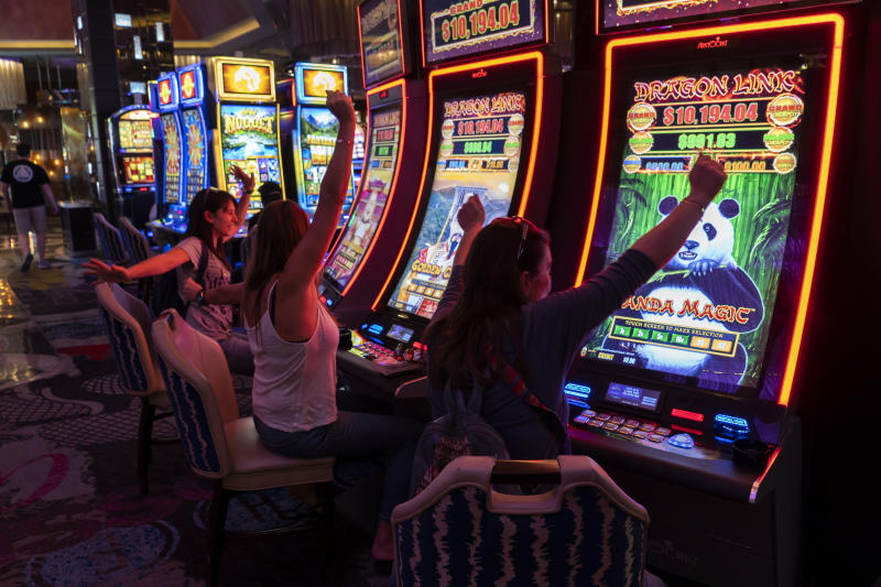 A group of girls play in the slot machines at the Excalibur hotel and casino in Las Vegas, USA, on 11 November 2019, (Photo by Joaquin Gomez Sastre/NurPhoto via Getty Images)