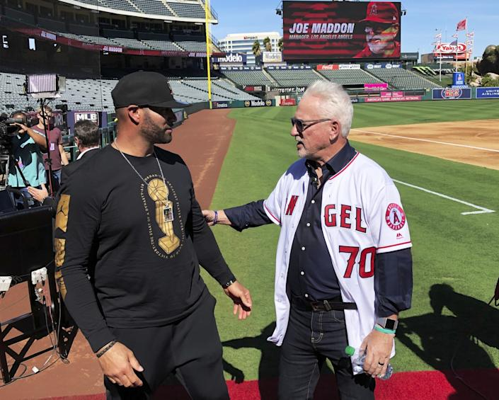 Los Angeles Angels first baseman Albert Pujols, left, speaks with new manager Joe Maddon after a baseball news conference at Angel Stadium