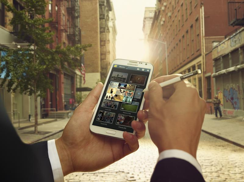 This undated image provided by Samsung shows the company's Note II phone. Over the past few years, smartphones have gradually gotten bigger and tablet computers have gotten smaller. So it should come as no surprise that devices in between are starting to emerge. These devices, informally known as phablets, are better described as giant phones than baby tablets, as they can be used for phone calls. And for now, they are closer in size to regular phones, with screens running 5 inches or more diagonally.. (AP Photo/HTC)