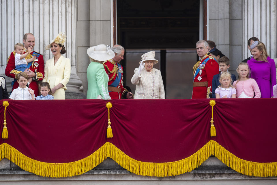 Even as the balcony filled the Cambridges and Sussexes kept their distance. Photo: Getty Images