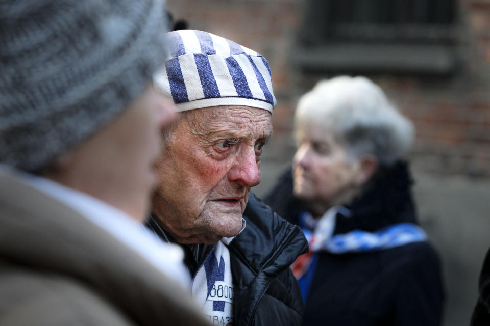 A survivor attends commemorations at the Auschwitz Nazi death camp in Oswiecim, Poland, Monday, Jan. 27, 2020. Survivors of the Auschwitz-Birkenau death camp gathered for commemorations marking the 75th anniversary of the Soviet army's liberation of the camp, using the testimony of survivors to warn about the signs of rising anti-Semitism and hatred in the world today.(AP Photo/Czarek Sokolowski)