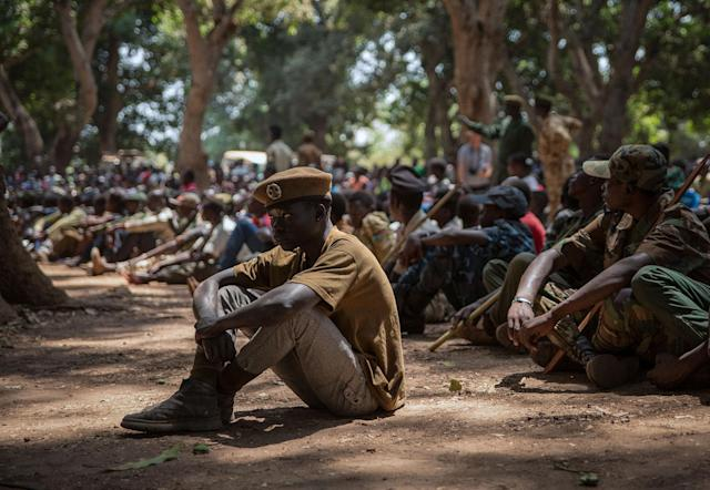 <p>Newly released child soldiers attend sit as they attend their release ceremony in Yambio, South Sudan on Feb. 7, 2018. (Photo: Stefanie Glinski/AFP/Getty Images) </p>