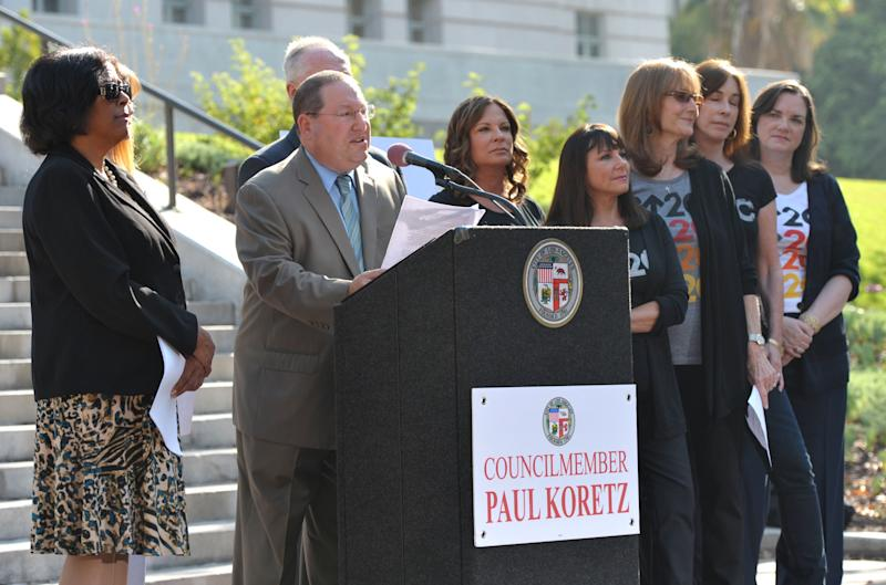 """Los Angeles Councilmember Paul Koretz, center, appears at the Stand Up To Cancer Day announcement at Los Angeles City Hall on Tuesday, Sept. 4, 2012. Koretz and the City of Los Angeles held the news conference to declare Friday, Sept. 7 as the official """"Stand Up To Cancer Day"""" in Los Angeles. (Photo by John Shearer/Invision/AP)"""