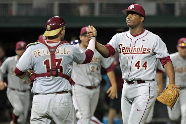 Florida State pitcher Jameis Winston, right, celebrates with catcher Danny de La Calle after the Seminoles swept Clemson in an NCAA college baseball doubleheader at Doug Kingsmore Stadium in Clemson, S.C. on Saturday, March 22, 2014. Florida State won the first game 11-1, and took the nightcap 4-3.(AP Photo/Anderson Independent-Mail, Mark Crammer)