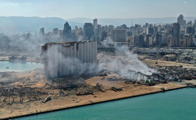 Beirut's port was left devastated by a massive blast on August 4, 2020, here photographed one day after the explosion, including damaging containers of chemicals which are now being cleared