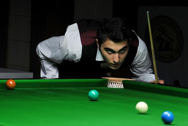 Iran's Hossein Vafaei Ayouri lines up a shot during the IBSF World Snooker Championship in Bangalore on December 03, 2011. Hossein Lee Walker of Wales by 10 frames to nine. AFP PHOTO/Manjunath KIRAN (Photo credit should read Manjunath Kiran/AFP/Getty Images)