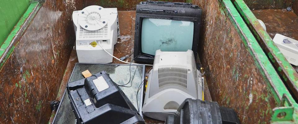 Used tv sets and monitors, other electronic appliances at recycling center.