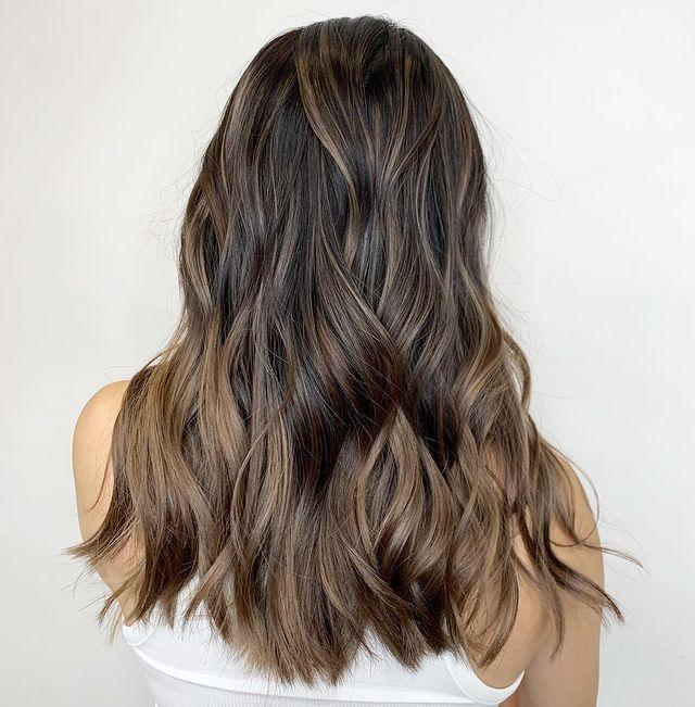 """<p>My favorite thing about this ash-brown <a href=""""https://www.cosmopolitan.com/style-beauty/beauty/g35203490/spring-2021-hair-trends/"""" rel=""""nofollow noopener"""" target=""""_blank"""" data-ylk=""""slk:hair idea"""" class=""""link rapid-noclick-resp"""">hair idea</a> is<strong> how freaking <em>blended</em> the highlights look</strong>. If you're trying to go the natural-looking route, show your colorist this pic.</p><p><a href=""""https://www.instagram.com/p/B3CXbw6nGND/"""" rel=""""nofollow noopener"""" target=""""_blank"""" data-ylk=""""slk:See the original post on Instagram"""" class=""""link rapid-noclick-resp"""">See the original post on Instagram</a></p>"""