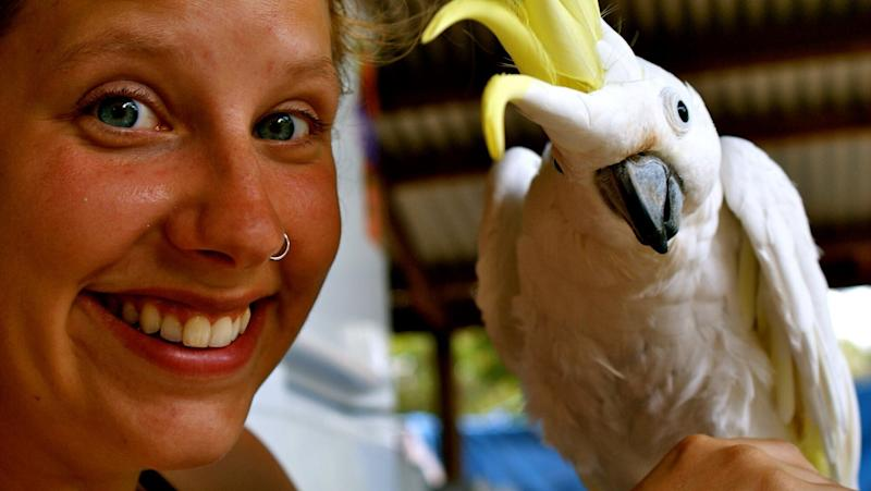 Mum Tanja Ludwig pictured with a bird. She died with her toddler daughter on Tuesday. Both went over the Robertson Lookout in the Illawarra region.