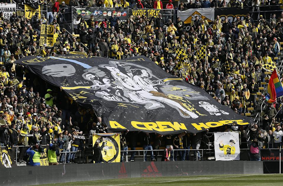 Columbus Crew SC fans in the Nordecke unveil a TIFO during the first half of the MLS match against New York City at Mapfre Stadium in Columbus on Sunday, March 1, 2020. [Adam Cairns/Dispatch]