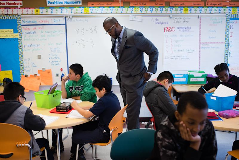 Antwan Wilson visits a fifth-grade math class at the Brightwood Education Campus in Washington, D.C. on Feb. 1, 2017. (The Washington Post via Getty Images)