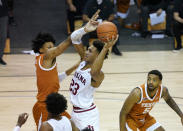 Indiana forward Trayce Jackson-Davis (23) looks to the basket in between Texas forward Gerald Liddell (0), left, and Texas forward Royce Hamm Jr. (5) in the first half of a semifinal NCAA college basketball game in the Maui Invitational tournament, Tuesday, Dec. 1, 2020, in Asheville, N.C. (AP Photo/Kathy Kmonicek)