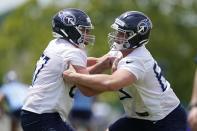 Tennessee Titans guard Cole Banwart, left, and defensive tackle Chandon Herring, right, run a drill during NFL football rookie minicamp Saturday, May 15, 2021, in Nashville, Tenn. (AP Photo/Mark Humphrey, Pool)