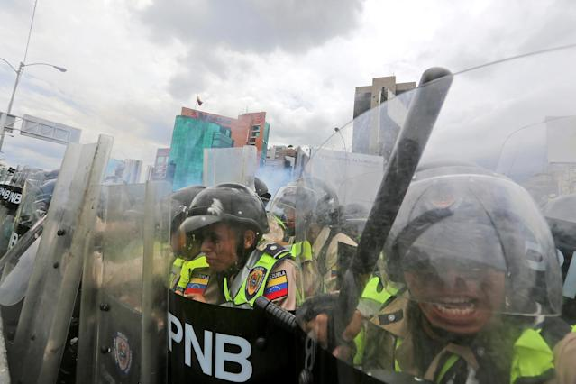 <p>Police push demonstrators with their shields during a protest in Caracas, June 7, 2016. (AP/Fernando Llano) </p>