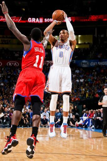 OKLAHOMA CITY, OK - JANUARY 4: Russell Westbrook #0 of the Oklahoma City Thunder shoots against Jrue Holiday #11 of the Philadelphia 76ers on January 4, 2013 at the Chesapeake Energy Arena in Oklahoma City, Oklahoma. (Photo by Layne Murdoch/NBAE via Getty Images)