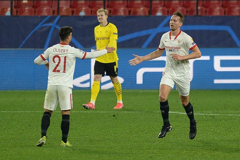 Luuk de Jong (R) scored a late goal which gives Sevilla hope heading into next month's second leg