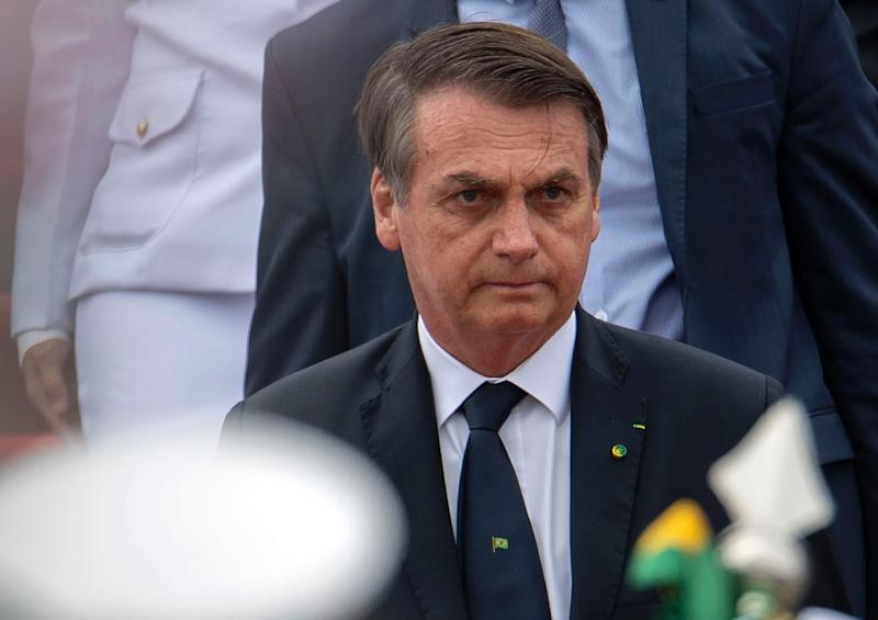Pro-gun Brazilian president Jair Bolsonaro, whose tough-on-crime rhetoric helped him get elected, signed a controversial order allowing members of a wide range of professions to carry guns on the street or at work (AFP Photo/Mauro Pimentel)