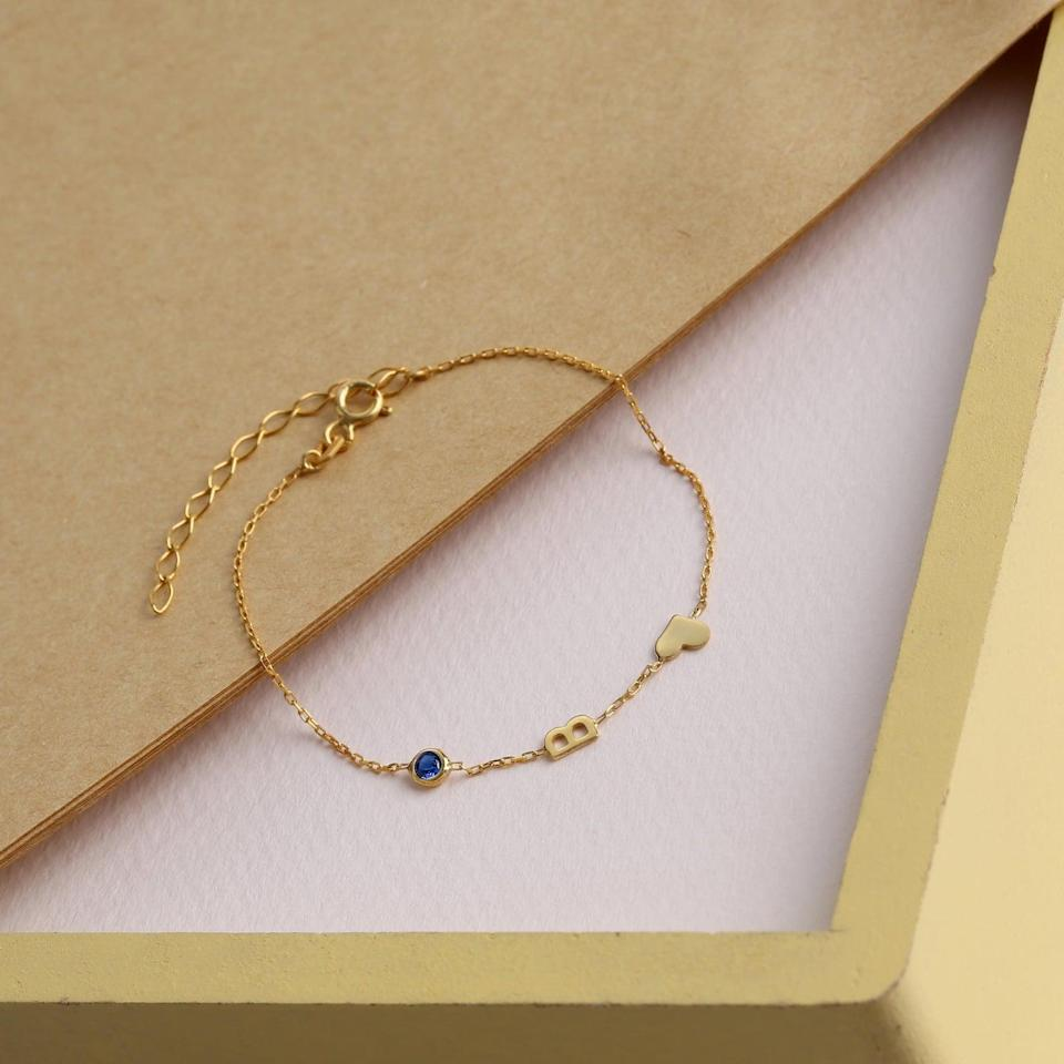 <p>This eye-catching <span>LA Personalized Gold initial Bracelet</span> ($14 and up) will get you tons of compliments.</p>