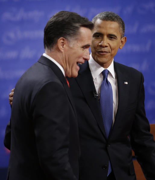 President Barack Obama, right and Republican presidential nominee Mitt Romney chat following the first presidential debate at the University of Denver, Wednesday, Oct. 3, 2012, in Denver. (AP Photo/David Goldman)