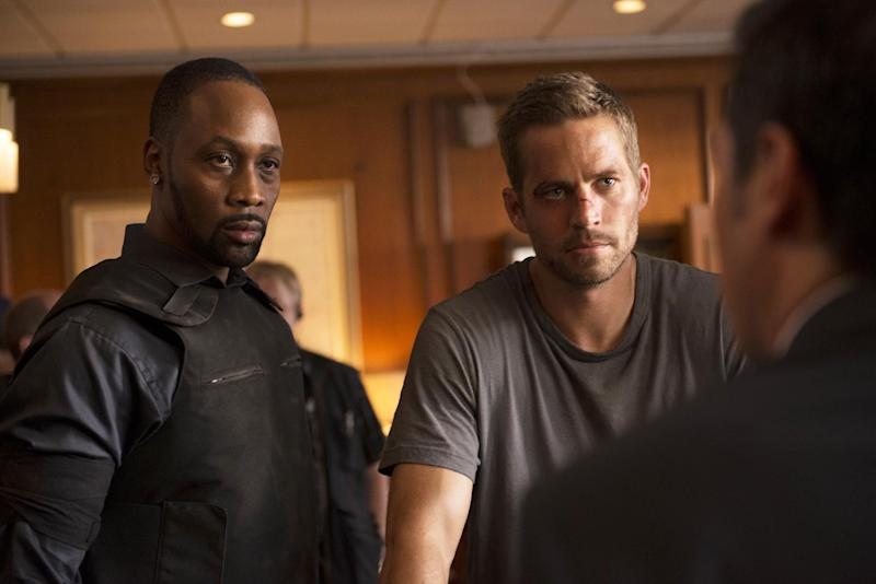 "This image released by Relativity Media shows RZA, left, and Paul Walker in a scene from ""Brick Mansions."" (AP Photo/Relativity Media, Philippe Bosse)"